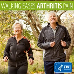 Older couple walking in the park. Text says Walking eases arthritis pain.