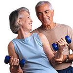 Middle-aged couple working out