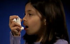 young girl using an asthma inhaler