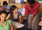 Teacher assisting students in classroom