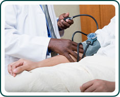 A patient having their blood pressure taken by a doctor.