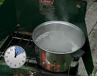 A pot of boiling water with a clock showing a boil time of 10 minutes