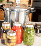 Canning: Pressure Cooker used for Preserving Homegrown Fruits Vegetables
