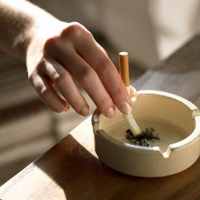 Photo: Putting a cigarette out in an ashtray.