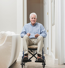 Senior man at home in a wheelchair