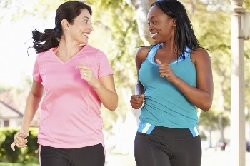 Photo of two young women jogging