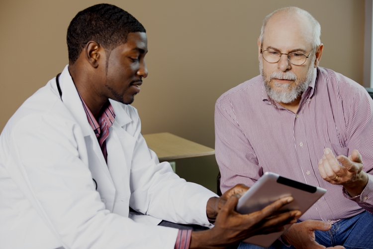 Photo of a patient talking to his doctor