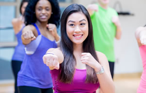 Photo of a young women participating in an aerobics class