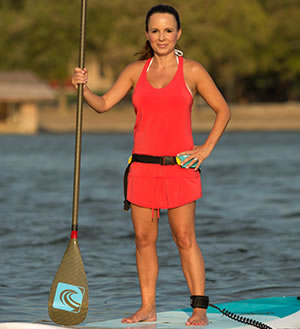 Cassie on top of a paddle board