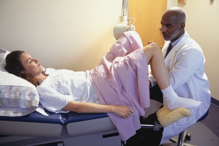 Photo of a doctor performing a Pap test
