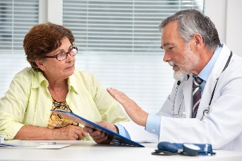 Photo of a woman asking her doctor a question