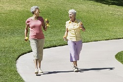 Photo of two women walking outdoors