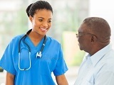 Photo of a nurse talking to a man