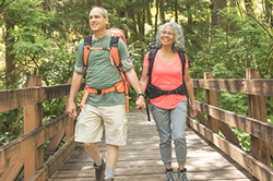 Photo of a middle-aged couple walking in the forest