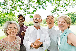 Photo of a group of older adults gathered outdoors
