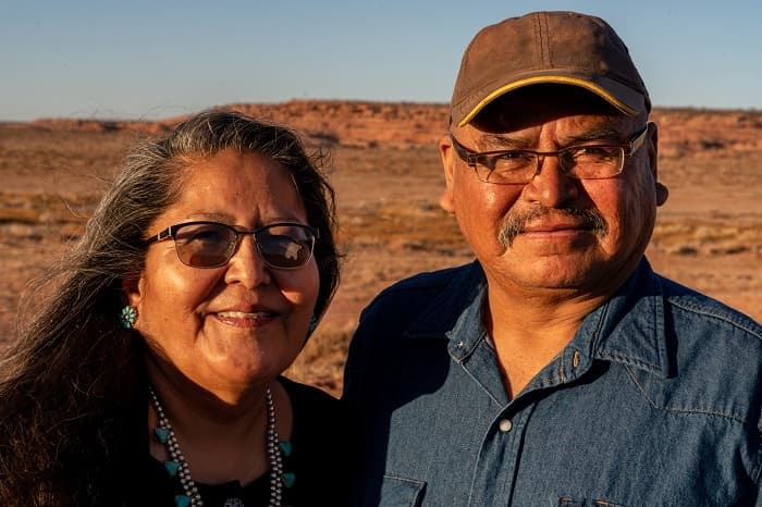 Photo of an American Indian husband and wife near their home in Monument Valley, Utah.