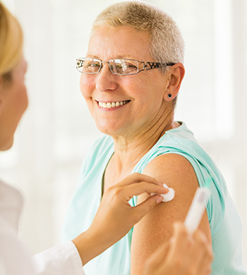 A nurse giving a flu shot to a patient