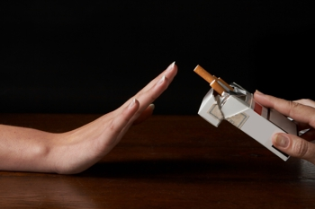 Photo of a person refusing a cigarette
