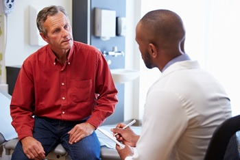 Photo of a man talking to his doctor