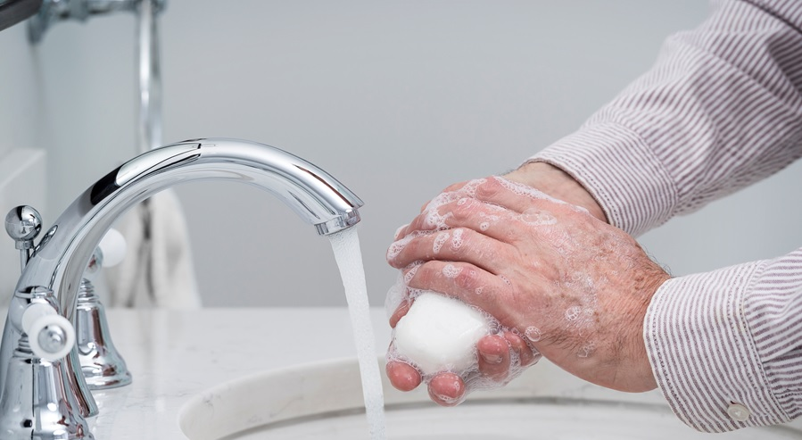 Photo of a man washing his hands