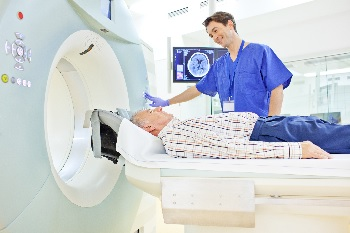 Photo of a man receiving a CT scan