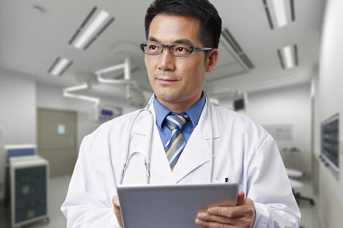 Photo of a doctor holding a digital tablet