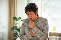 Photo of a woman coughing