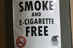 "Sign on pole that reads ""The Pool Atrium is Now Smoke and E-Cigarette Free."""
