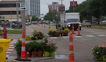 Road in Lake Charles, Louisiana, with cones, bicycle lanes, and pottery.