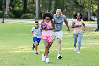 Photo of a family spending time together, having fun in the park.