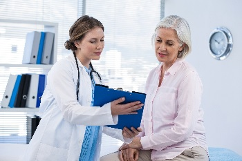 Photo of a woman talking to her doctor