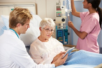 Photo of a woman in a hospital talking to her doctor