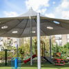 Photo of a school playground with shaded structures.