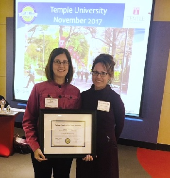 Photo of Dr. Sherry Pagoto presenting Dr. Carolyn Heckman with the Skin Smart Campus award for Temple University.