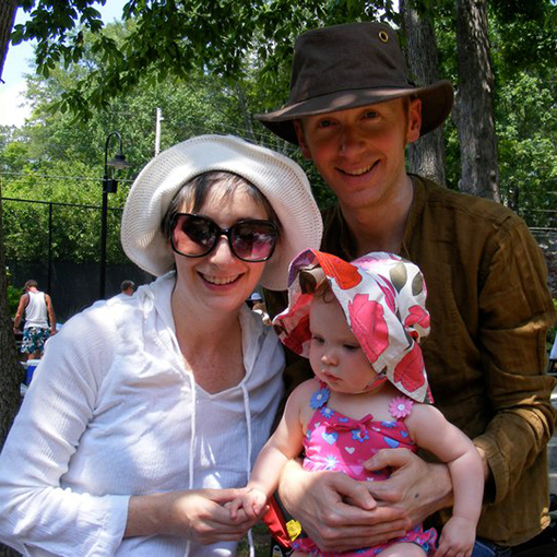 Meg Watson with husband and child wearing sun protection gear.