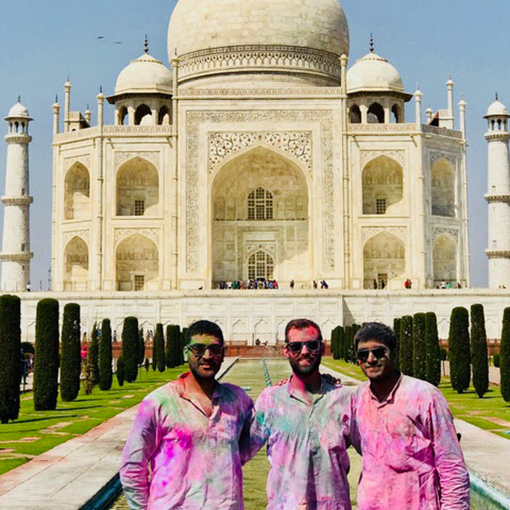 Photo of Ravi, Taylor, and Neil staying sun-safe while visitng the Taj Majal.
