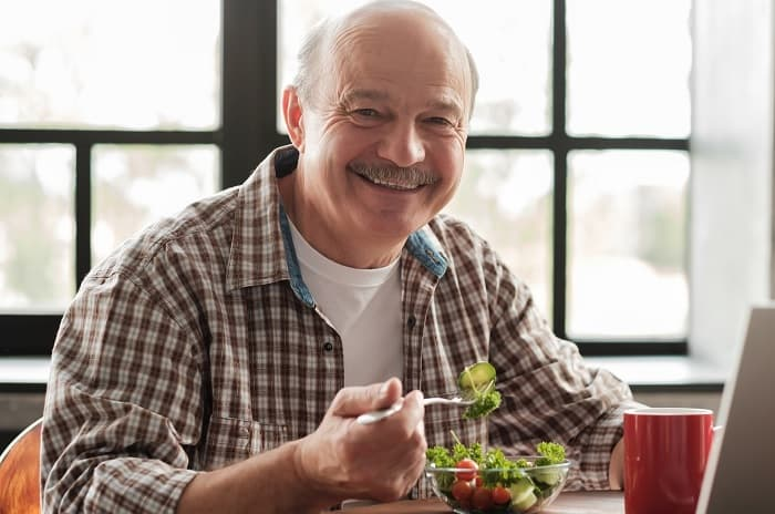 Photo of a man eating a salad