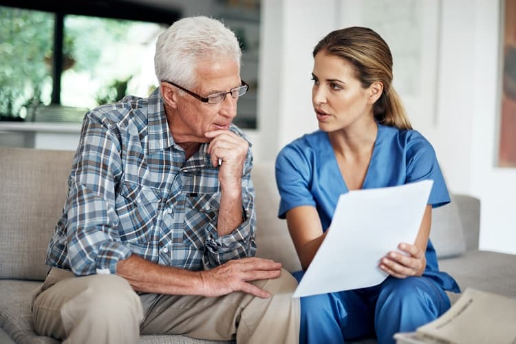 Photo of a nurse discussing a survivorship care plan with a patient