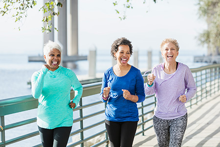 Group of three women working out.
