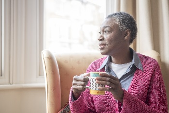 Photo of a woman drinking coffee