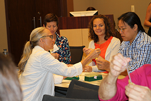 Teachers learning how epidemiology and laboratory science are used to investigate outbreaks.