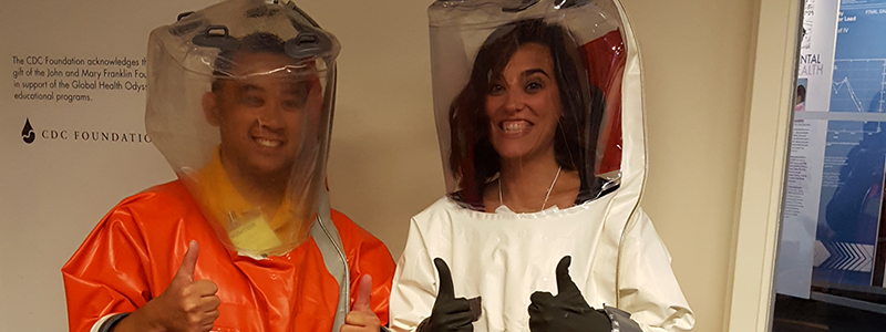 Science Ambassador fellows trying on biosafety suits.