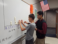 students working on white board