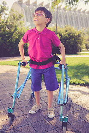 A boy using a walker
