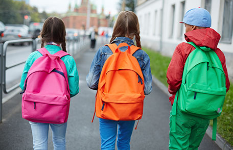 Three kids walking with backpacks