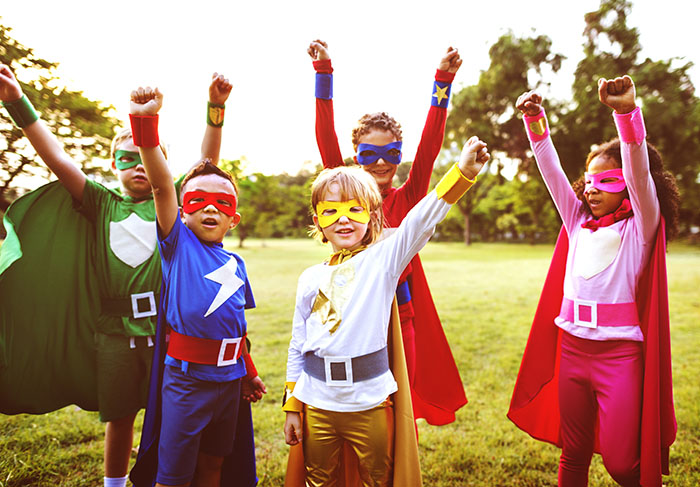 Kids dressed as superheroes