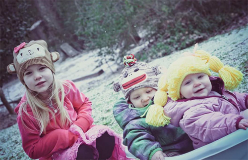 Savannah, Caden, and Kylie play in the snow after they arrived home.