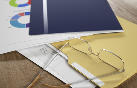 Photo of papers, folders, and a pair of glasses