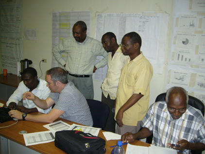 CDC's Ezra Barzilay (second from left), working with country partners to set up a nationwide database that will help track cholera cases
