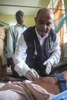 A physician checking a patient for dehydration